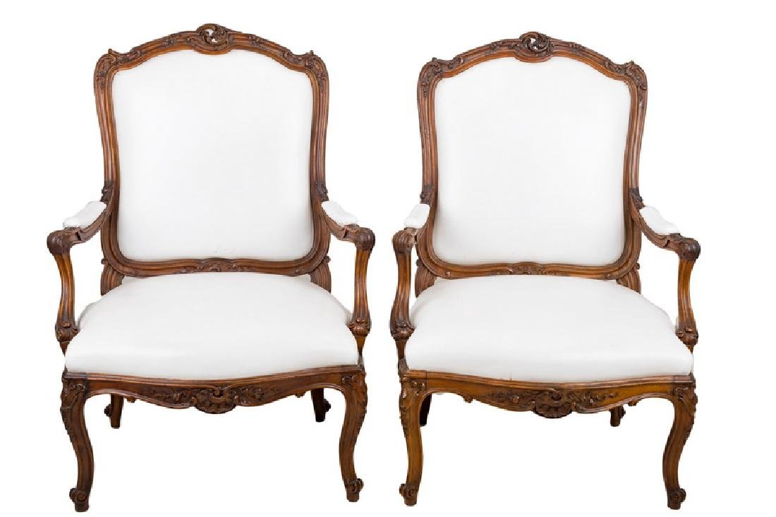 PAIR OF LOUIS XV STYLE CARVED WALNUT FAUTEUILS