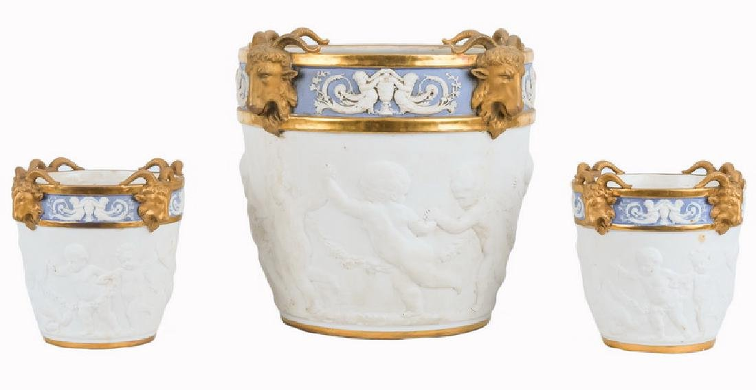 SEVRES BISQUE PORCELAIN THREE-PIECE CACHE POT SUITE