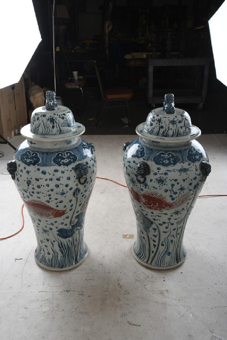 PAIR OF MONUMENTAL CHINESE BLUE & WHITE TEMPLE URNS - 3