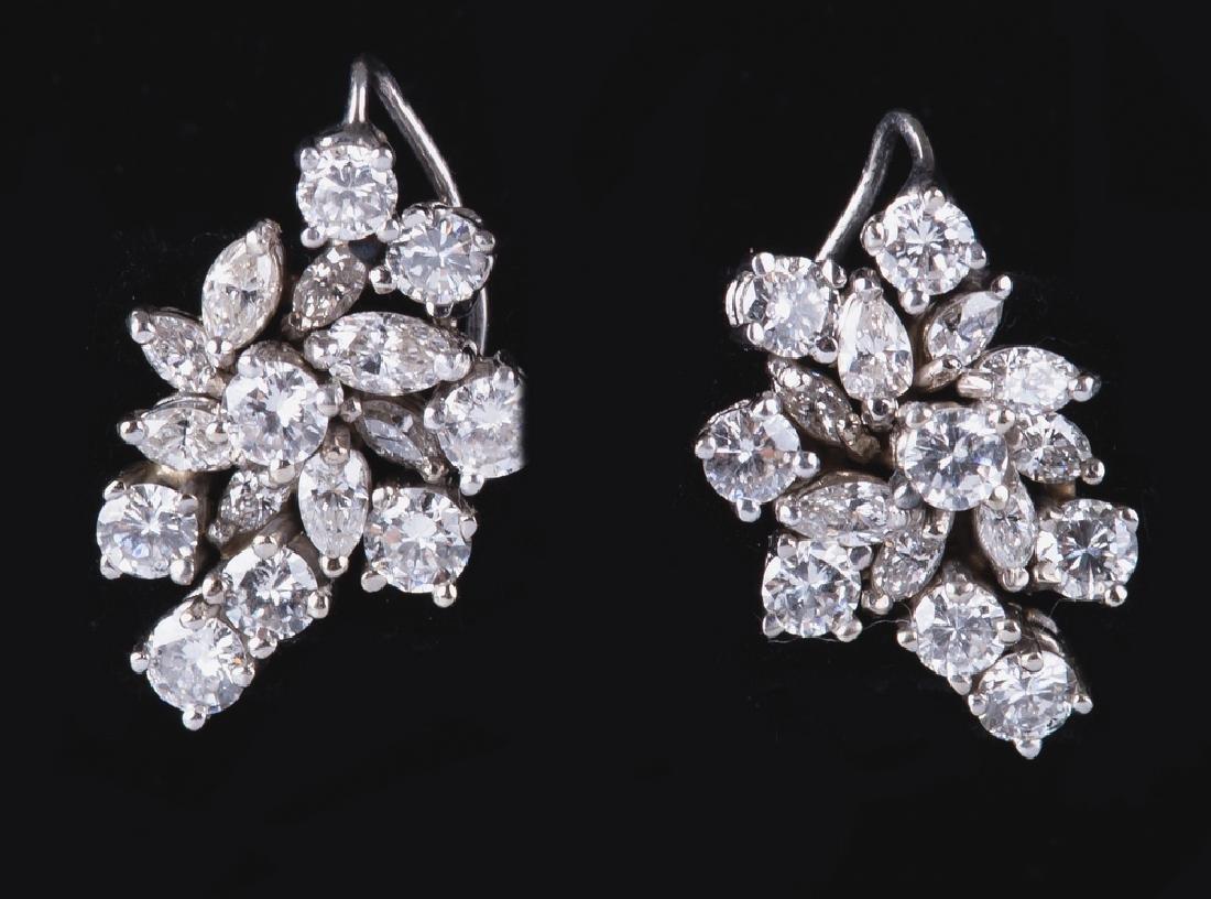 PAIR OF 14 KARAT WHITE GOLD & DIAMOND CLUSTER EARRINGS