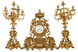 FRENCH LOUIS XV STYLE GILTBRONZE THREE PIECE CLOCK SET