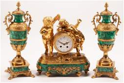 FRENCH GILT BRONZE  MALACHITE THREEPIECE CLOCK SET