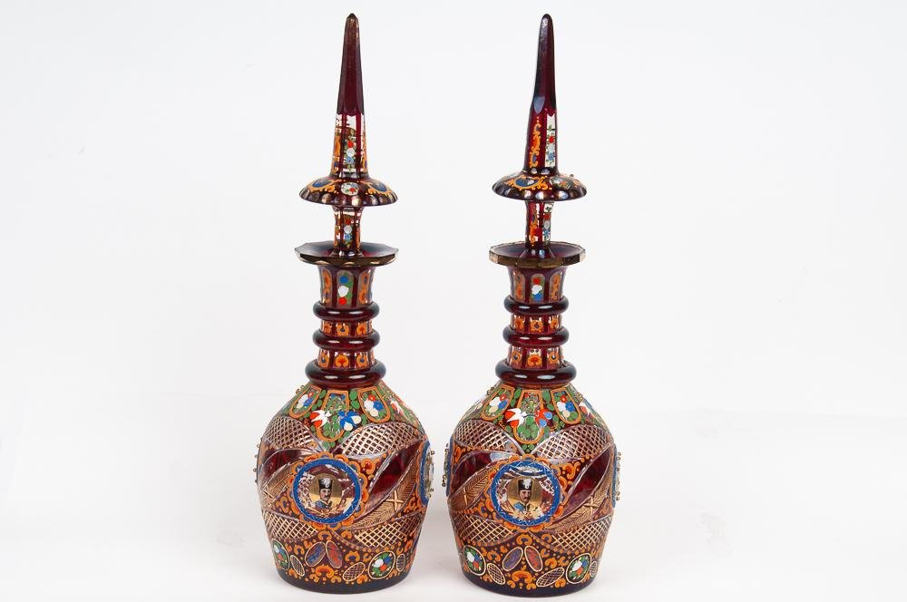PAIR OF PERSIAN ENAMEL DECORATED GLASS DECANTERS