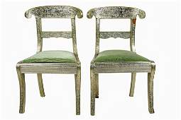 FOUR ANGLO INDIAN SILVERED METAL CHAIRS