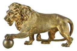 GILT BRONZE FIGURE OF A LION