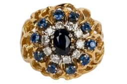 18 KARAT YELLOW GOLD, SAPHIRE, & DIAMOND CLUSTER RING