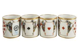 FOUR SEVRES PORCELAIN PLAYING CARD TEA CUPS