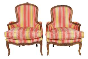 PAIR OF LOUIS XV STYLE CARVED WALNUT BERGERES