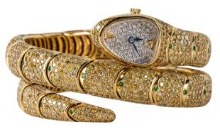 18 KARAT YELLOW GOLD, DIAMOND, & GARNET SNAKE WATCH