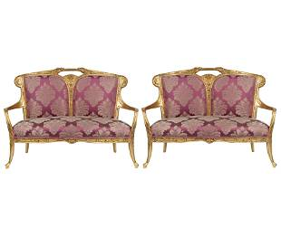 PAIR OF ART NOUVEAU STYLE CARVED GILTWOOD SETTEES
