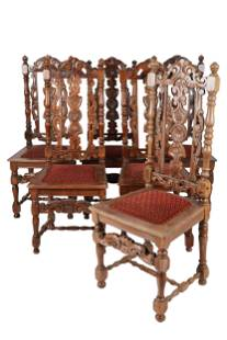 TWELVE CARVED WALNUT DINING CHAIRS