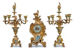 102 FRENCH GILT BRONZE AND CHAMPLEVE THREEPIECE CLOCK