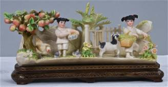 508: CHINESE CARVED AND POLYCHROME IVORY GROUP