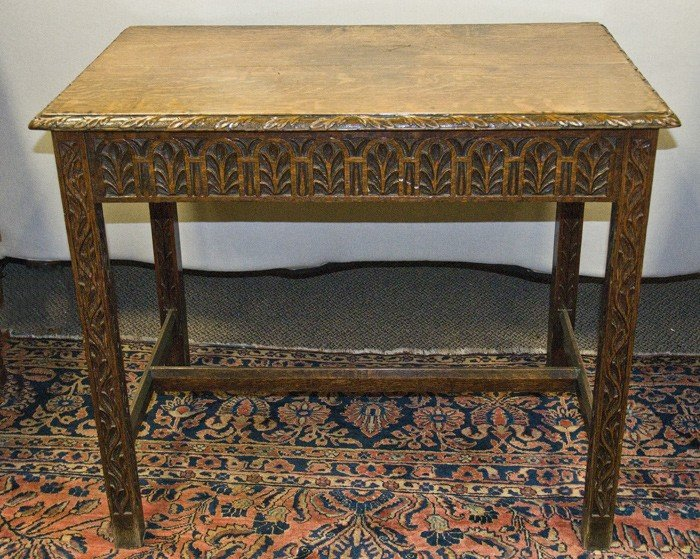 44: TUDOR STYLE OAK WRITING TABLE