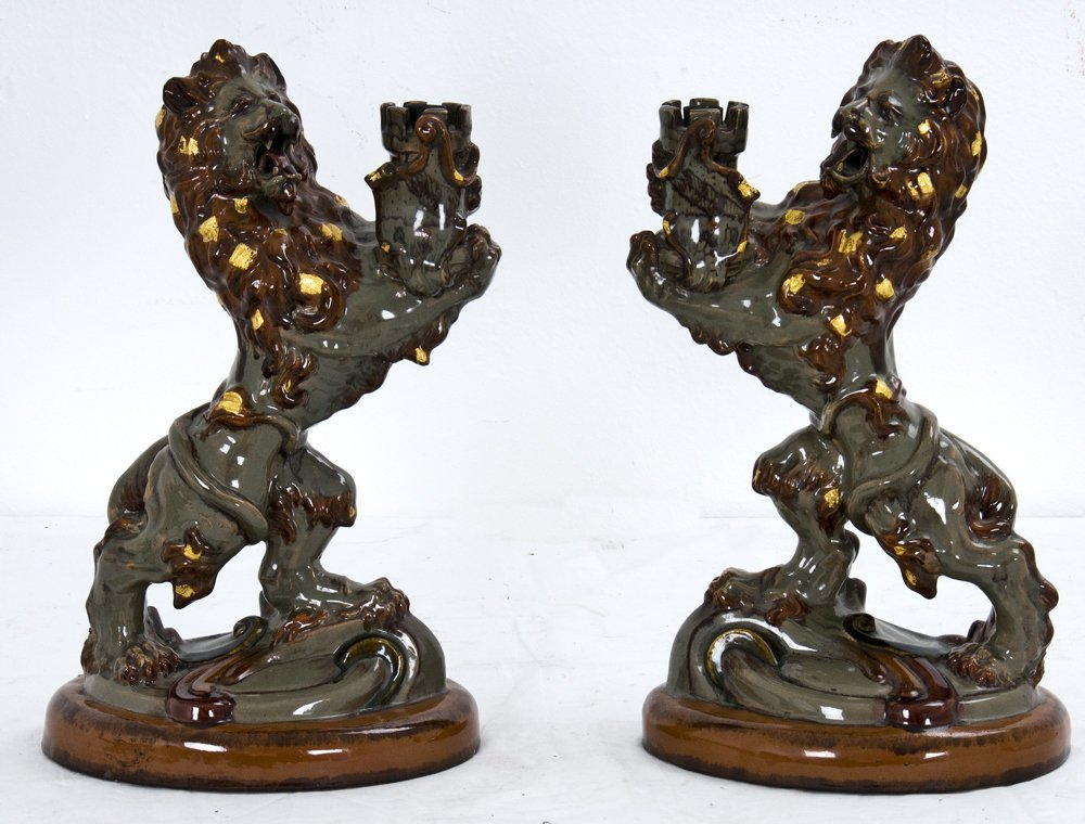 20: PAIR OF GALLE FAIENCE LION FORM CANDLE STICKS