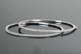 TWO 18 KARAT WHITE GOLD & DIAMOND BANGLE BRACELETS