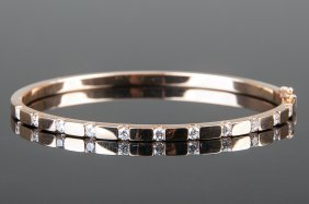 14 KARAT ROSE GOLD & DIAMOND BANGLE BRACELET