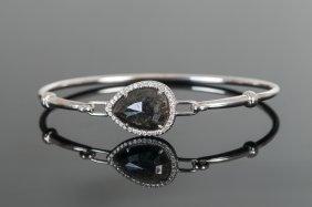 NEIL LANE: 18 KARAT WHITE GOLD & BLACK DIAMOND BANGLE