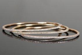 THREE 18 KARAT GOLD & DIAMOND BANGLE BRACELETS