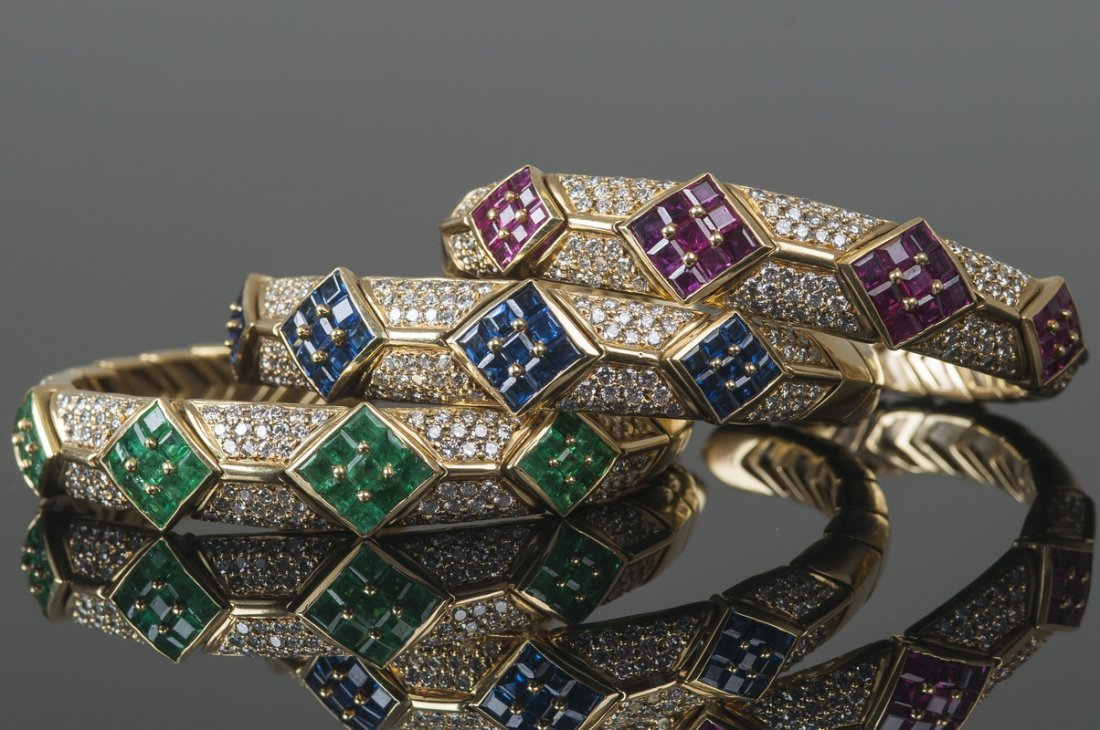 THREE 18 KARAT GOLD, DIAMOND, & COLORED STONE CUFF