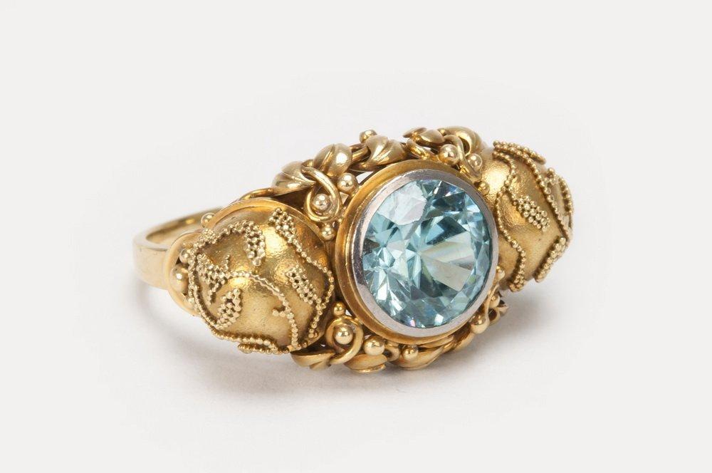 18 KARAT GOLD & ZIRCON RING