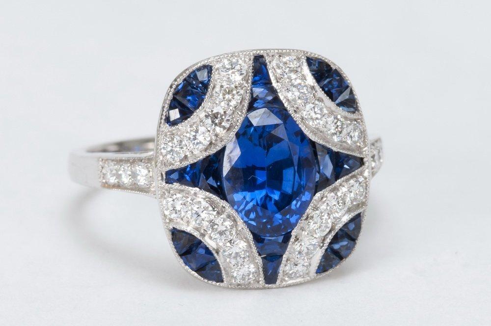 18 KARAT WHITE GOLD, SAPPHIRE, & DIAMOND RING