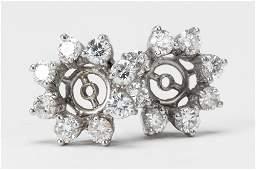 PAIR OF PLATINUM  DIAMOND EARRING JACKETS