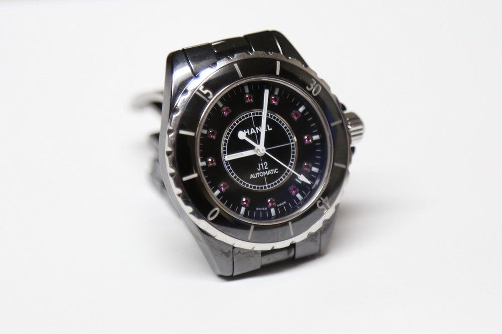 CHANEL J12 BLACK CERAMIC WATCH WITH PINK SAPPHIRE ON