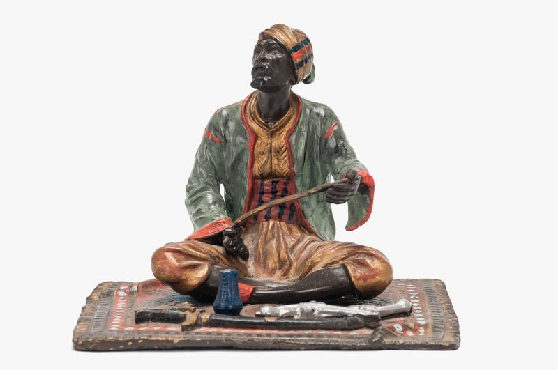 VIENNESE PATINATED BRONZE ARMS SELLER