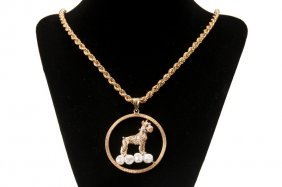 14 KARAT GOLD DOG PENDANT