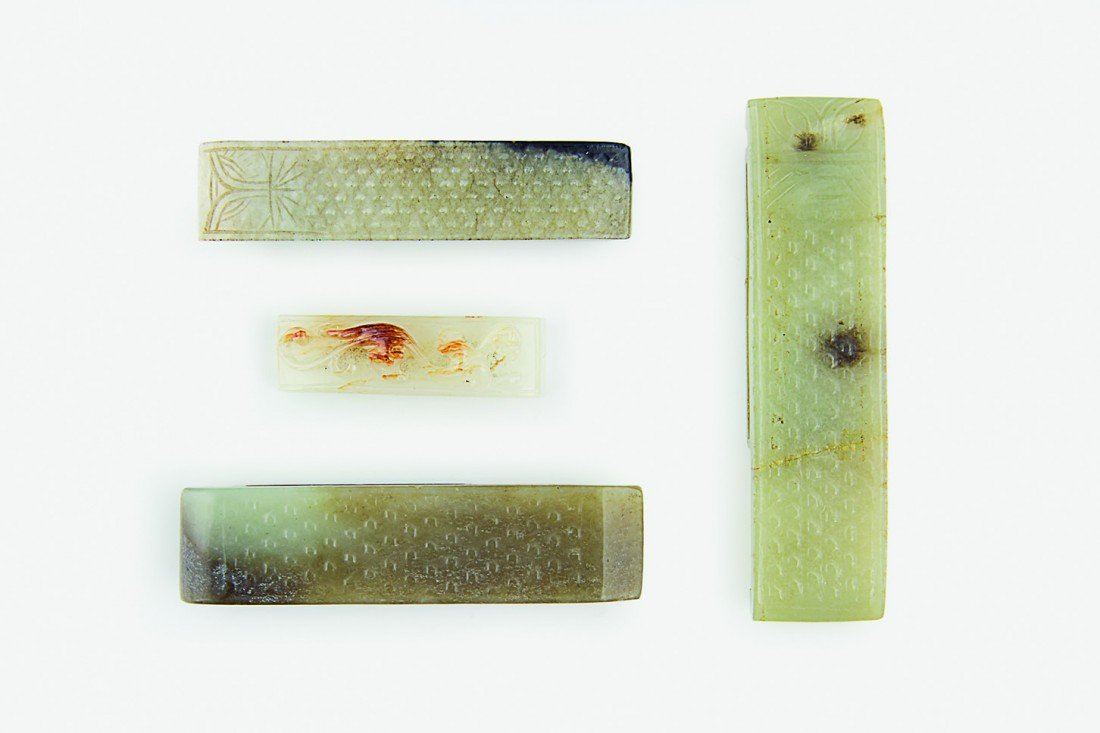 6: A group of four jade sword slides