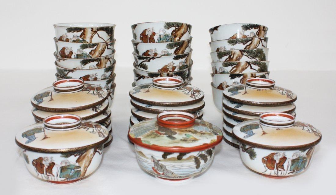 Boxed set of twenty Japanese Kutani bowls and covers