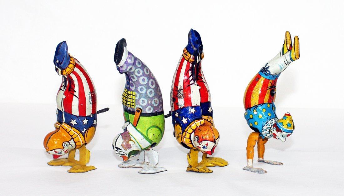 4 handstand clowns