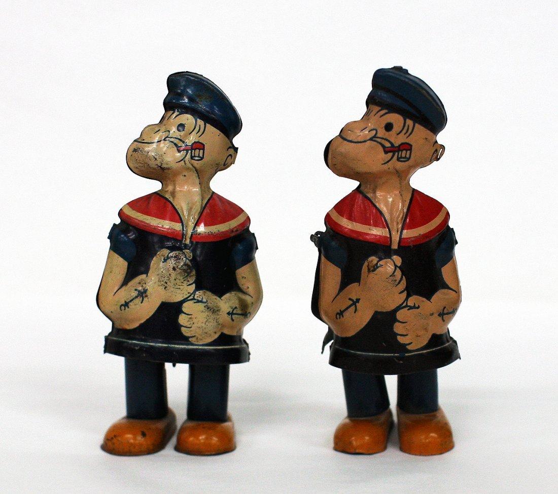 2 Popeye waddling figures