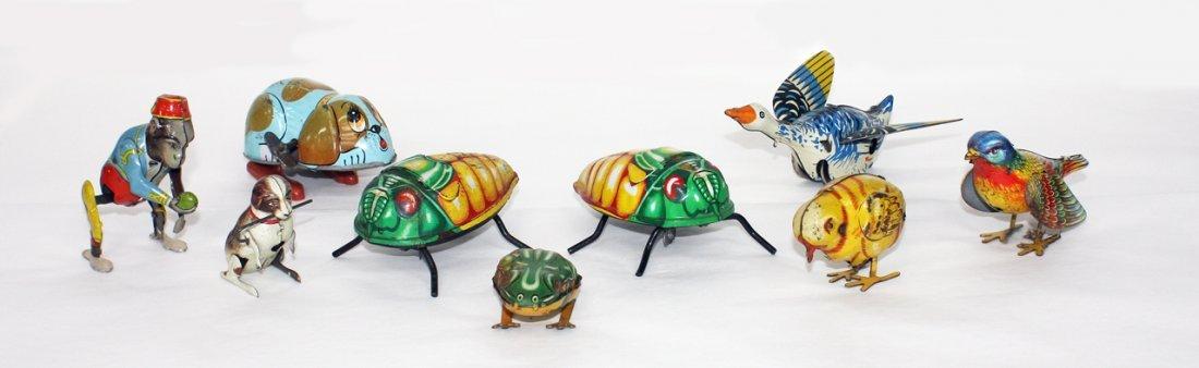 9 small hopping & crawling Tin Toys