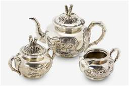 Chinese sterling silver threepiece tea set