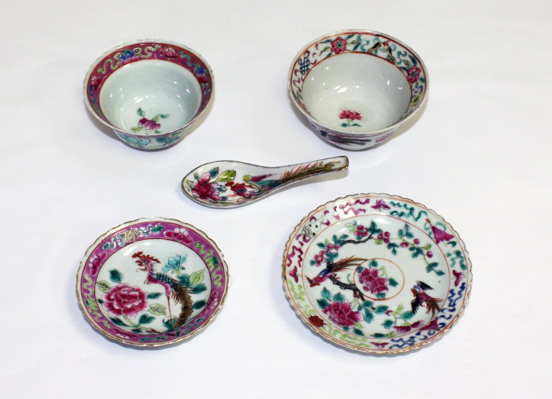 Two Chinese famille rose cups and saucers