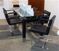 Le Corbusier designed LC6 glass topped dining table
