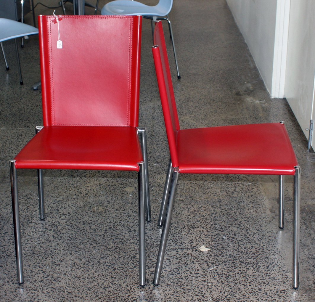 A pair of Italian Effezeta red leather side chairs