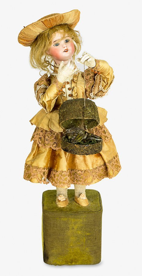 French musical automaton girl with bird in basket