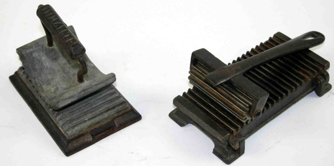 15: Two (2) Cast Iron Fluters, Each Having Ribbed Base,