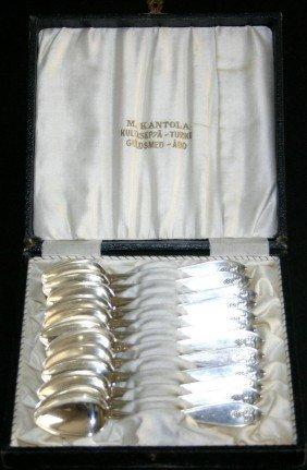 10: Set of twelve (12) solid silver demitasse spoons wi