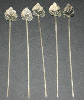 13: Seven (7) sterling leaf design iced tea spoon stirr