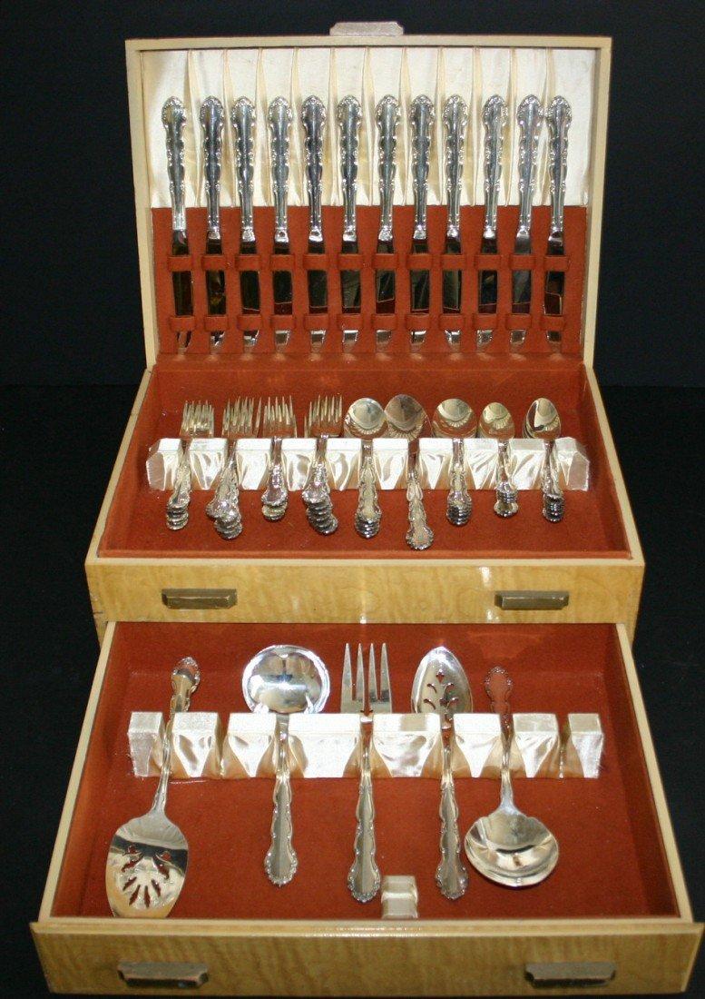 77: Sixty-six (66) piece 1881 Rodgers flatware set with