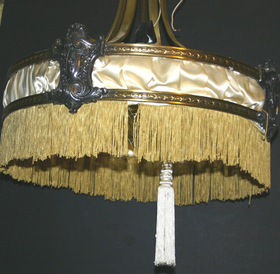 311: Ornate cast and brass chandelier with fringes.