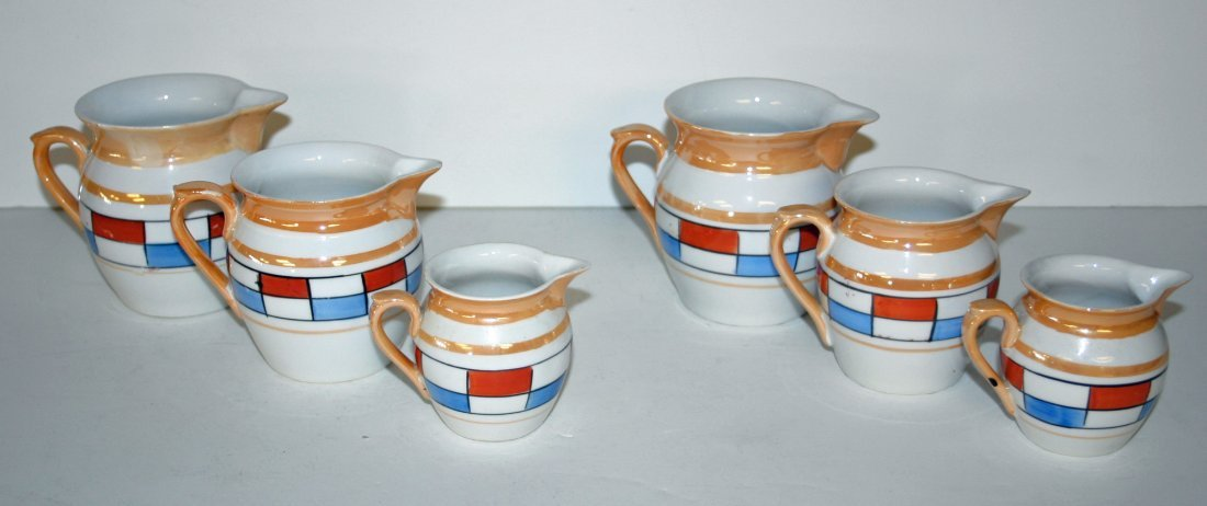 Two (2) sets of Czech Measuring Pitchers