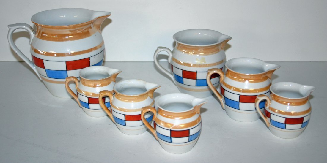One (1) set of Czech Measuring Pitchers, One (1) Large