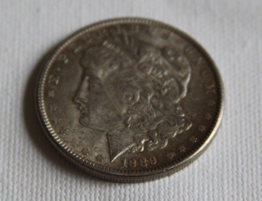12: 1889 Morgan Silver Dollar