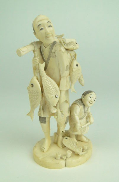 13: ANTIQUE ORIENTAL IVORY GROUPING