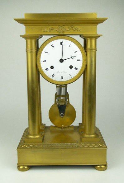 1: FRENCH 19C EMPIRE BRONZE CLOCK
